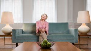 Lady sitting on blue couch